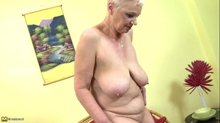 Busty granny undressing and playing with her bra buddies and snatch