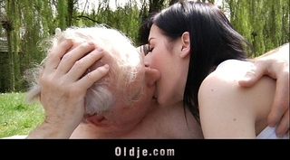 Young brunette hair wench bonks with old man in the park